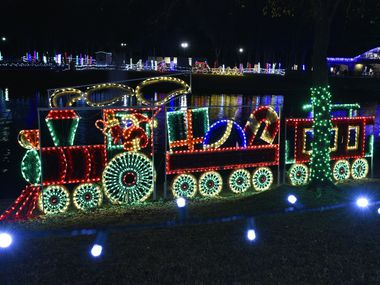 In this 2018 file photo, Santa Claus train and other Christmas themed lights decorate the banks of Centennial Park in Irving during the annual holiday Christmas light display. Cities across North Texas are grappling with how to safely host traditional Christmas events during the coronavirus pandemic this year.