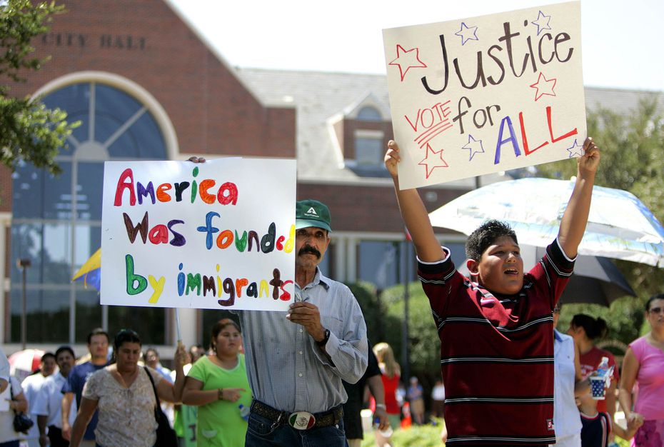 Protesters marched in front of Farmers Branch City Hall in 2006 to protest ordinances dealing with immigration.