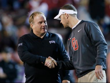 TCU head coach Gary Patterson, left, and Oklahoma head coach Lincoln Riley shake hands before their NCAA college football game in Norman, Okla., Saturday, Nov. 11, 2017.