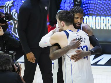 Dallas Mavericks guard Luka Doncic (77) hugs LA Clippers guard Paul George after the Clippers victory in Game 7 of an NBA playoff series at the Staples Center on Sunday, June 6, 2021, in Los Angeles.