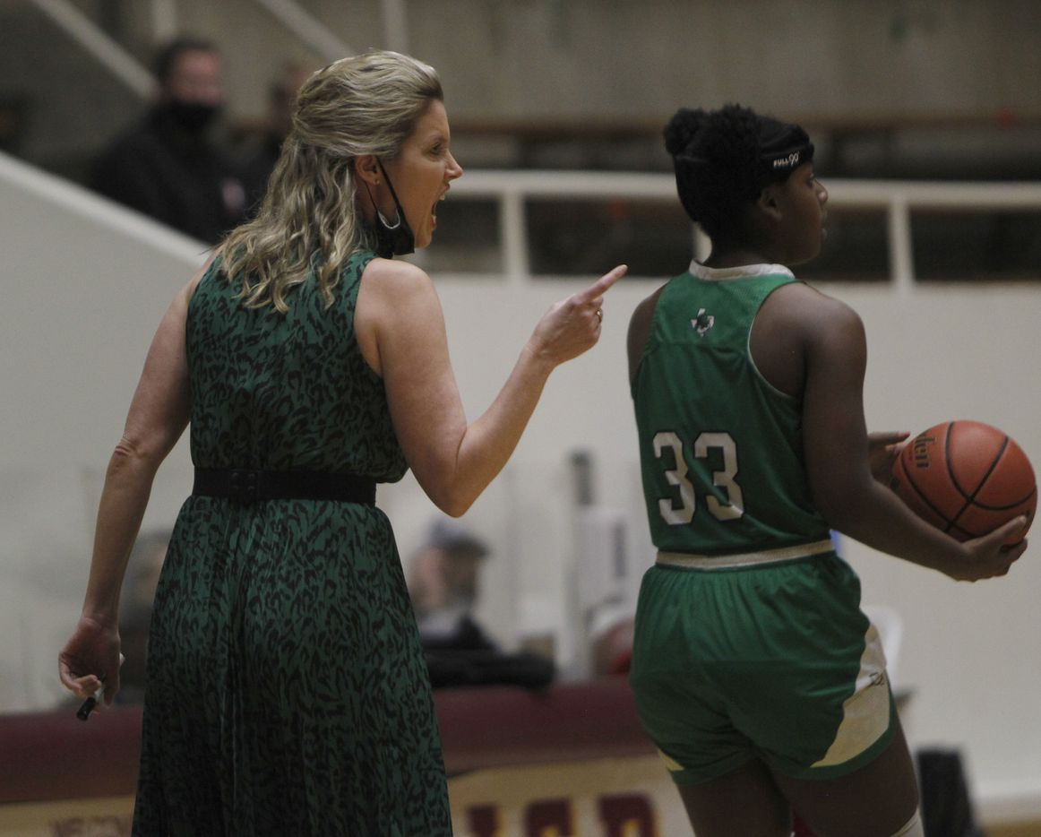 Southlake Carroll head coach Robyn McCoart gives some coaching advice as Lady Dragons forward Jordyn Sowell (33) prepares to put the ball back into play during first half action against Plano East. The two teams played their Class 6A regional semifinal girls playoff basketball game at Loos Field House in Addison on February 27, 2021. (Steve Hamm/ Special Contributor)