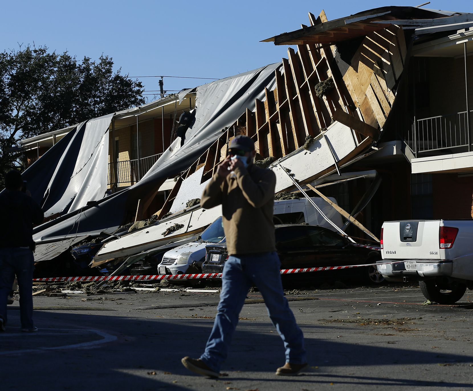 The roof of a Waterdance Apartments building was peeled off by a tornado-warned storm Tuesday night and landed on residents cars in the parking lot. Damage also occurred at The Mirage Apartments along Pioneer Parkway in Arlington, Wednesday, November 24, 2020.