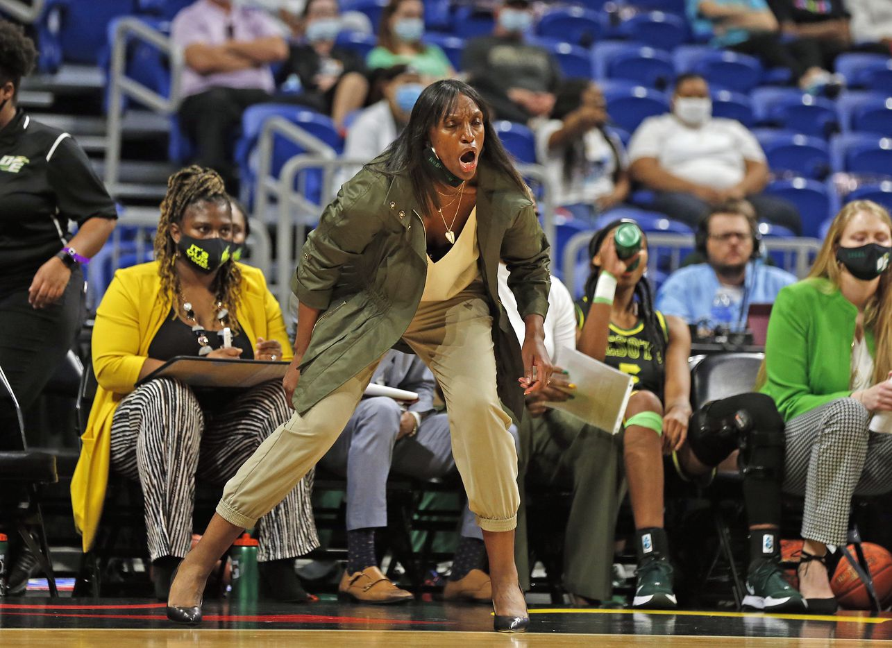 DeSoto head coach Andrea Robinson shouts out instruction. DeSoto vs. Cypress Creek girls basketball Class 6A state championship game on Thursday, March 12, 2021 at the Alamodome.