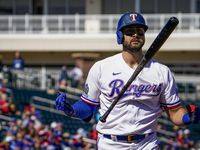 Texas Rangers outfielder Joey Gallo reacts after striking out during the first inning of a spring training game against the Kansas City Royals at Surprise Stadium on Tuesday, Feb. 25, 2020, in Surprise, Ariz.