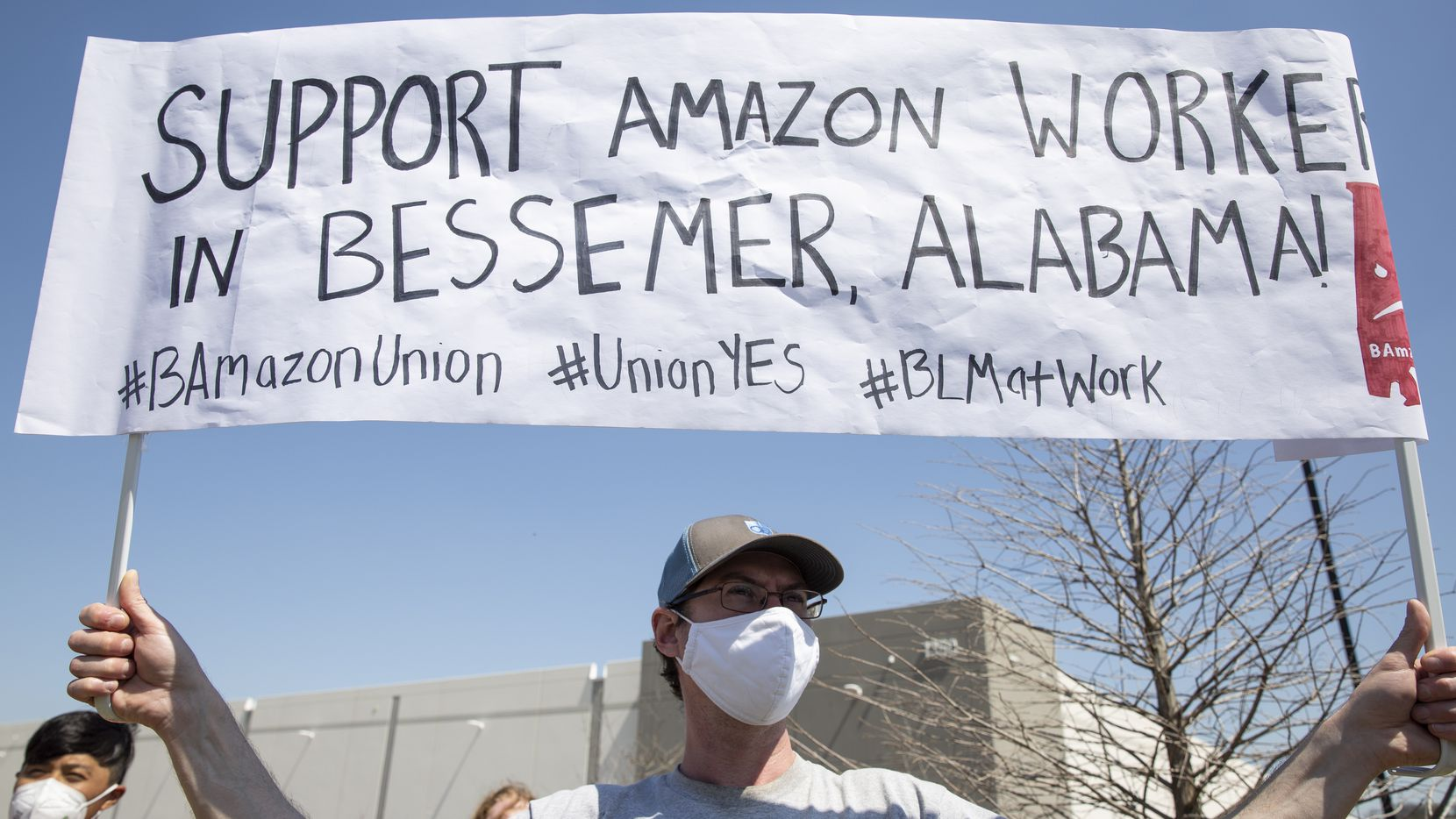 Joseph Barkell, a member of the International Workers of the World union, participates in a rally near the Amazon fulfillment center in Dallas at 1301 Chalk Hill Road earlier this month. The rally was organized by North Texas Socialist Alternative alongside organizations across the country engaging in an international day of solidarity with Amazon workers in Alabama.