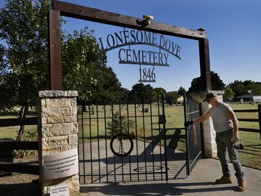 Maintenance man Joe Beatty closes the gate to the historic Lonesome Dove Baptist Cemetery after mowing one of the oldest cemeteries in Texas, September 16, 2021 in Southlake, Texas.