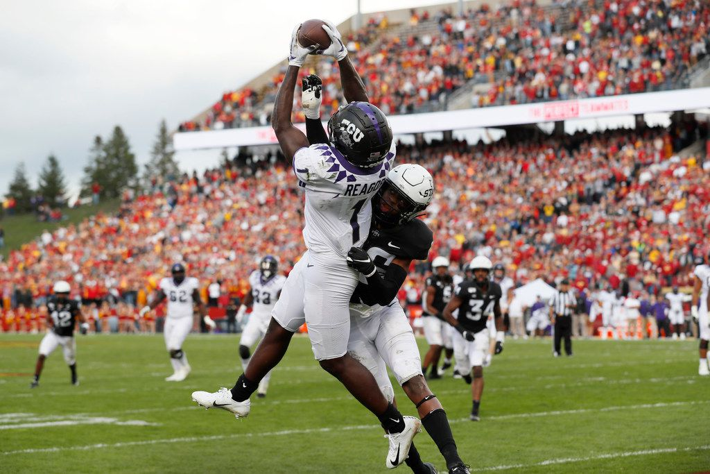 TCU wide receiver Jalen Reagor (1) catches a 7-yard touchdown pass over Iowa State defensive back Anthony Johnson during the second half of an NCAA college football game, Saturday, Oct. 5, 2019, in Ames, Iowa. Iowa State won 49-24. (AP Photo/Charlie Neibergall)