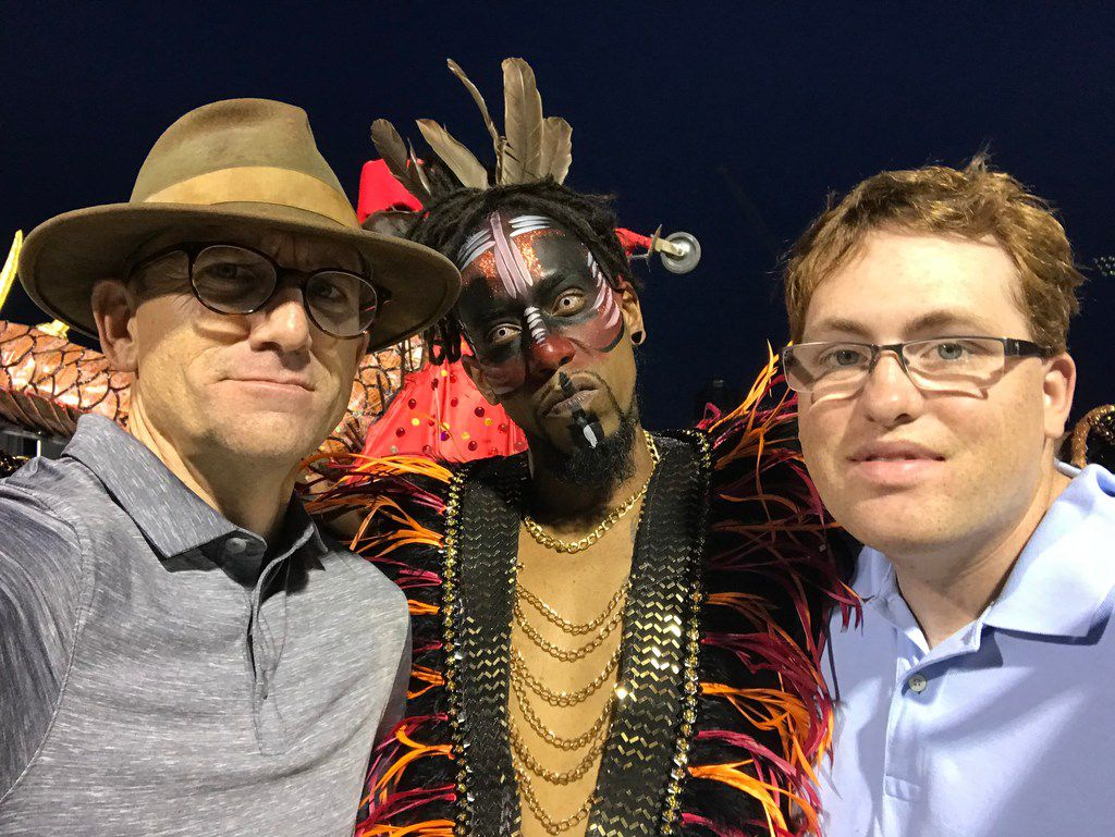 "Timed selfie of Tom Landis and Kalin O'Brien with a Canadian street dancer who helped the Dallas ""stars"" get into their costumes for the Toronto Carnival 2018 parade. Their participation in the world's largest street parade is part of an upcoming Canadian documentary,  Vacations of the Brave,  that features Howdy Homemade Ice Cream."