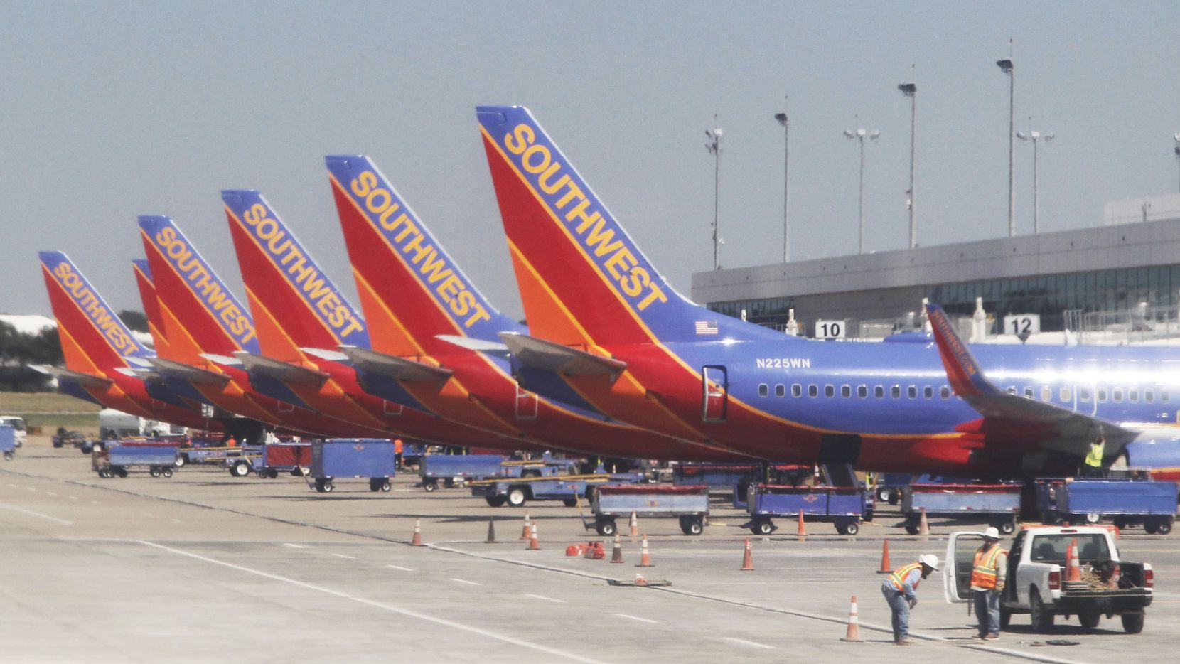 Southwest Airlines planes lined up at terminals at Dallas Love Field Airport in Dallas (Vernon Bryant/The Dallas Morning News)
