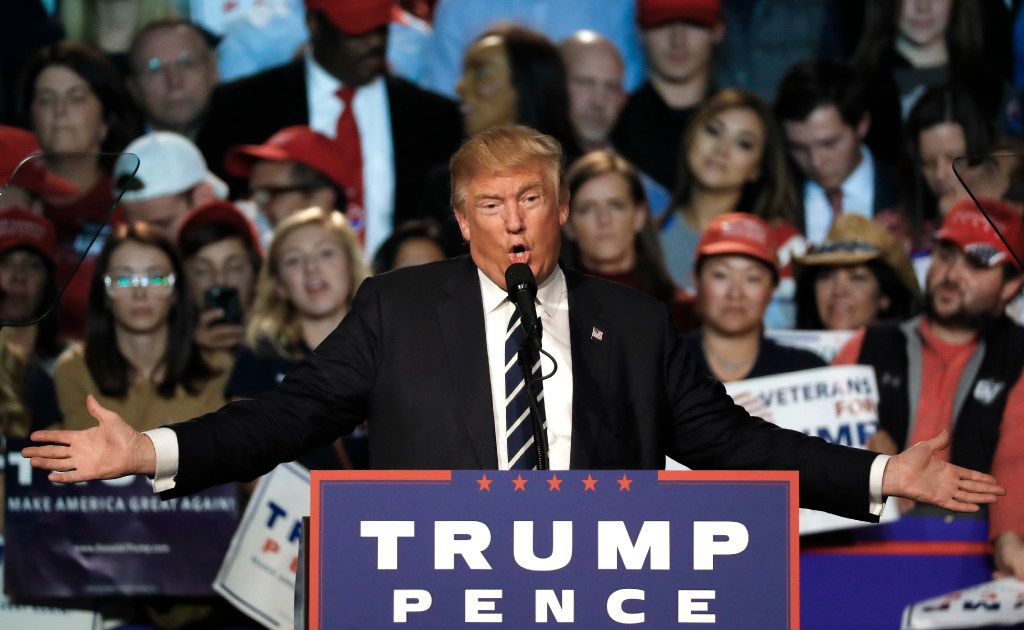 Building a wall, at Mexico's expense, was one of Trump's most popular applause lines during the campaign. (Paul Sancya/The Associated Press)