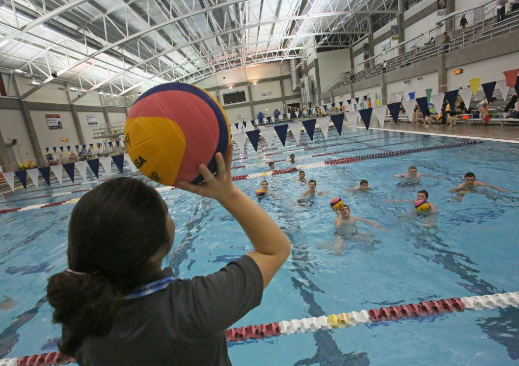 Coach Angela Uno works with the boys team during homeschool high school water polo practice at Rockwall Aquatic Center on Tuesday, February 17, 2015. (Louis DeLuca/The Dallas Morning News)