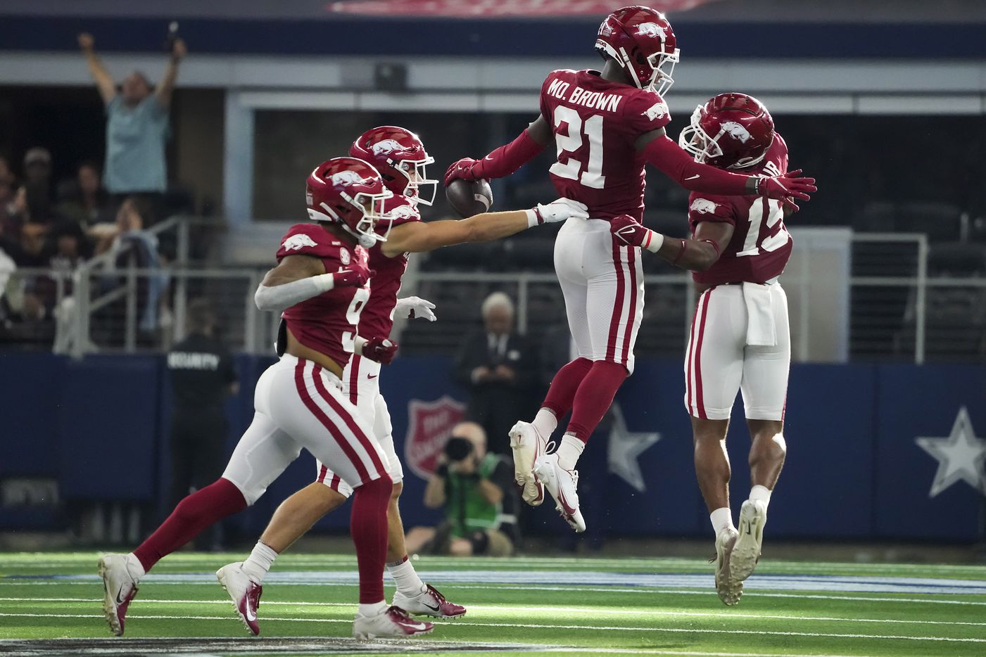 Arkansas defensive back Montaric Brown (21) celebrates after making a diving interception during the second half of an NCAA football game against Texas A&M at AT&T Stadium on Saturday, Sept. 25, 2021, in Arlington. Arkansas won the game 20-10.