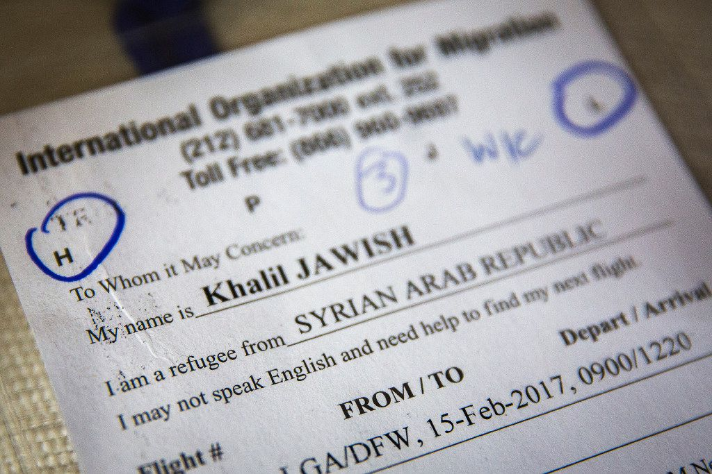 A name badge that was worn around his neck during transit identifies Khalil Jawish as a Syrian refugee.