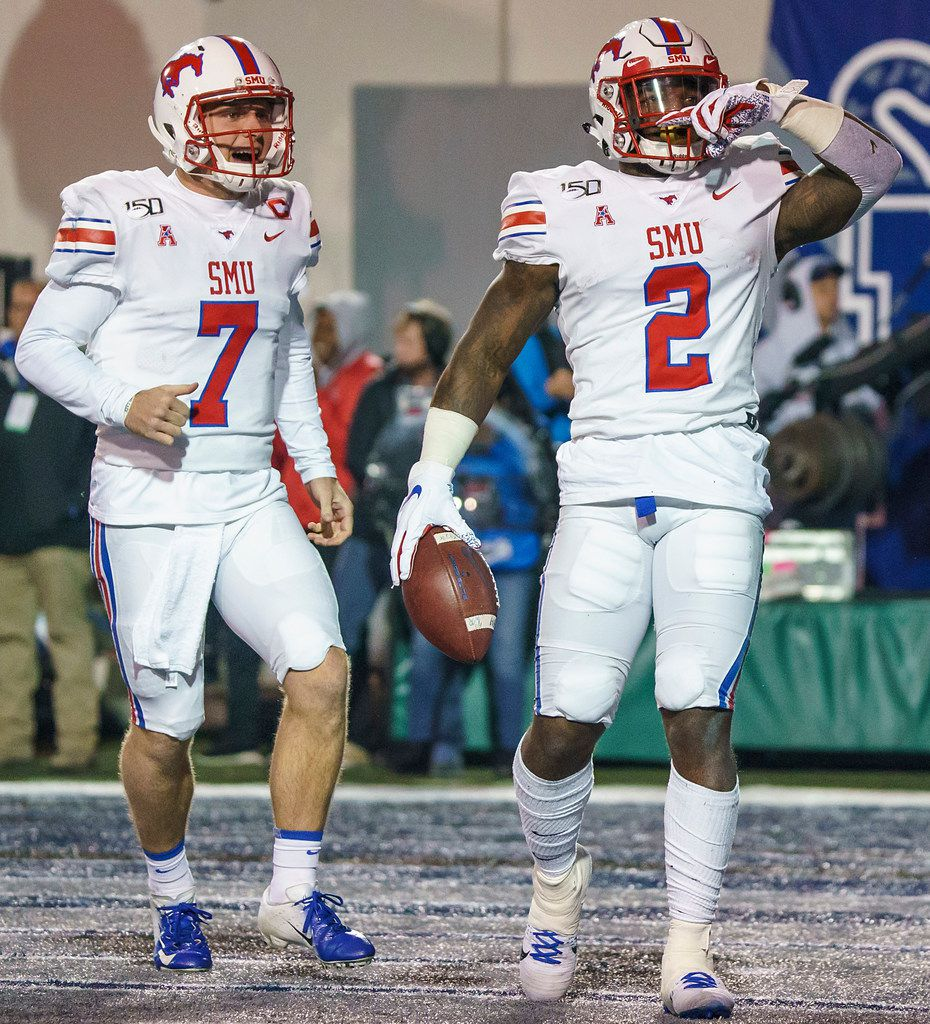 SMU running back Ke'Mon Freeman (2) celebrates with quarterback Shane Buechele (7) after scoring on a 2-yard touchdown run during the second half of an NCAA football game against Memphis at Liberty Bowl Memorial Stadium on Saturday, Nov. 2, 2019, in Memphis, Tenn. (Smiley N. Pool/The Dallas Morning News)