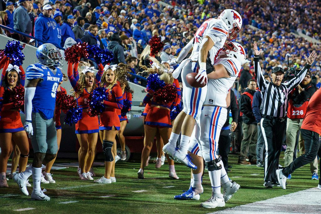 SMU tight end Kylen Granson (83) celebrates with offensive lineman Beau Morris (78) after scoring on a 16-yard touchdown reception past Memphis defensive back John Broussard Jr. (9) during the first half of an NCAA football game at Liberty Bowl Memorial Stadium on Saturday, Nov. 2, 2019, in Memphis, Tenn.