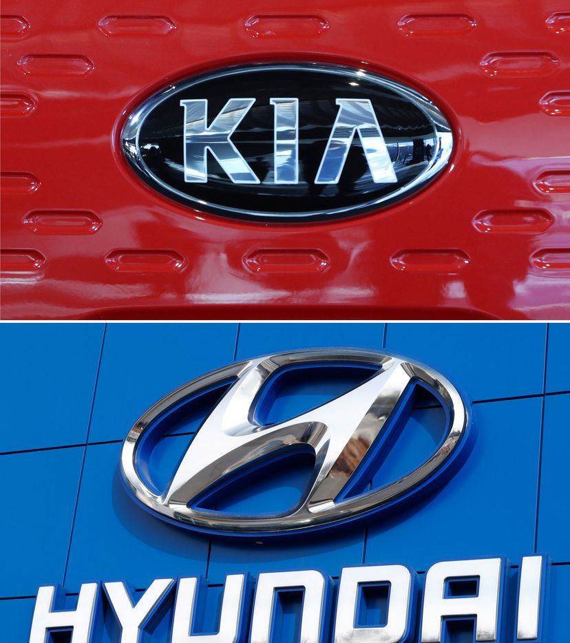 FILE- This combination of file photos shows the logo of Kia Motors during an unveiling ceremony on Dec. 13, 2017, in Seoul, South Korea, top, and Hyundai logo on the side of a showroom on April 15, 2018, in the south Denver suburb of Littleton, Colo., bottom. Hyundai and Kia are recalling more than a half million vehicles in the U.S. because of new problems that can lead to engine fires. Documents posted Thursday, Feb. 28, 2019, by the government show the Korean automakers are adding three recalls after reports of fires across the country. (AP Photo, File)