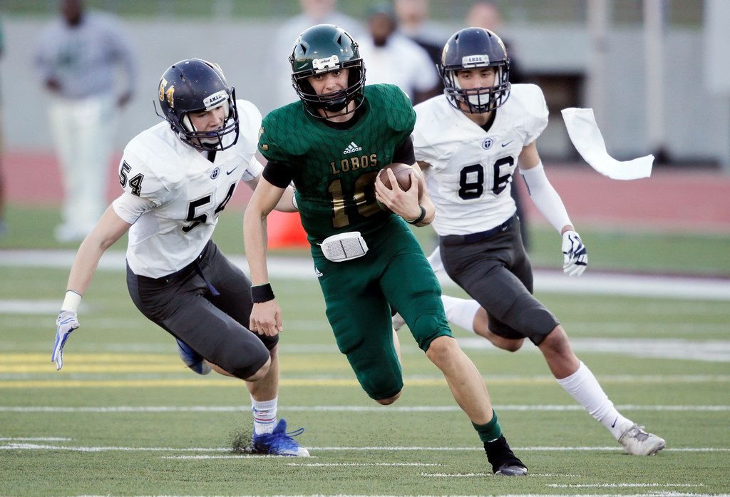 TXHSFB Longview sophomore quarterback Haynes King (10) evades Jesuit junior Collin Kenny (54) and sophomore defensive back Christian Allocco (86) during the first half of a high school Class 6A Division II play-off football game at John Kincaide Stadium, Saturday, November 25, 2017.