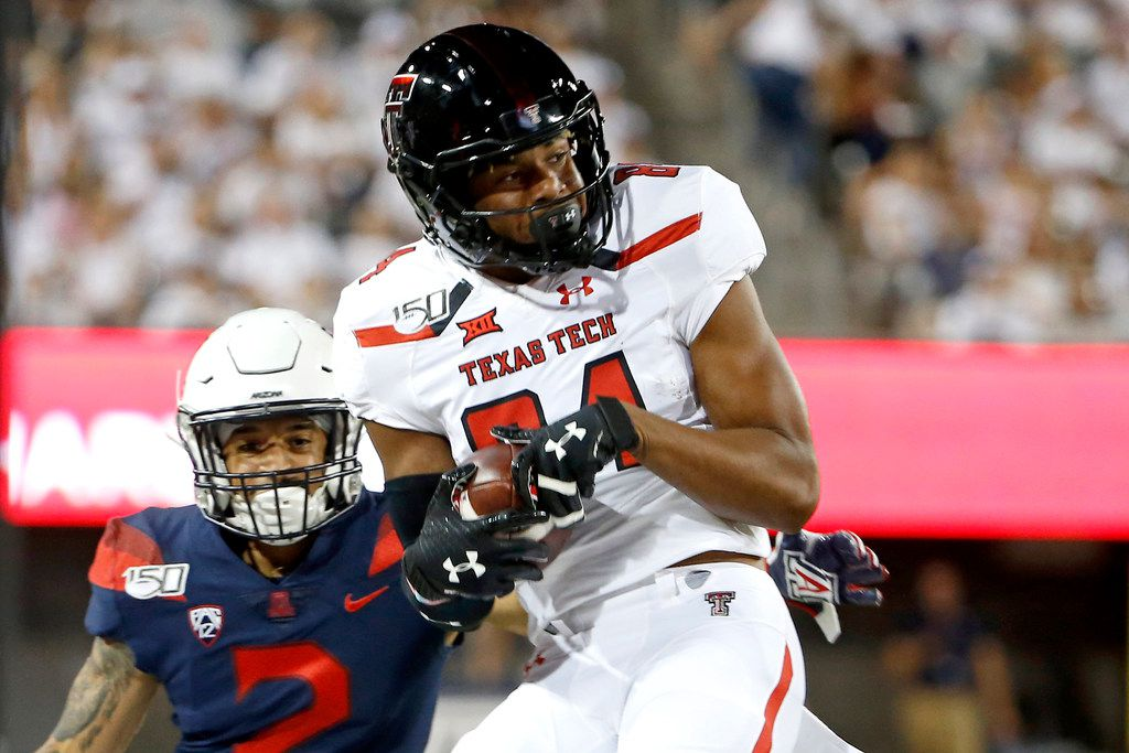 Texas Tech wide receiver Erik Ezukanma (84) catches the ball in front of Arizona cornerback Lorenzo Burns (2) during the first half of an NCAA college football game, Saturday, Sept. 14, 2019, in Tucson, Ariz. (AP Photo/Ralph Freso)