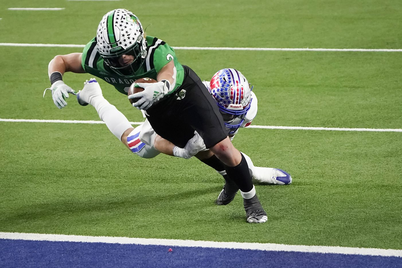 Southlake Carroll running back Owen Allen (2) scores past Austin Westlake defensive back Ford Dickerson (18) on a 3-yard touchdown run during the first quarter of the Class 6A Division I state football championship game at AT&T Stadium on Saturday, Jan. 16, 2021, in Arlington, Texas.