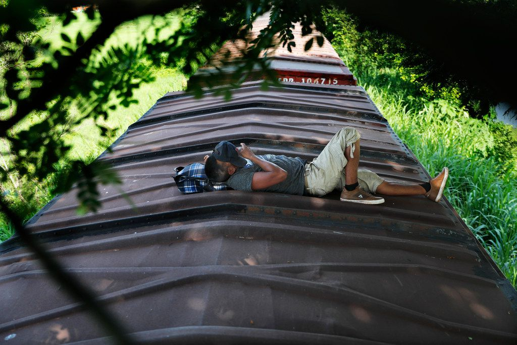 A Honduran migrant rides a freight train on his way north, in Salto del Agua, Mexico, Tuesday, June 25, 2019. Mexico has deployed 6,500 National Guard members in the southern part of the country, plus another 15,000 soldiers along its northern border in a bid to reduce the number of migrants traveling through its territory to reach the U.S.