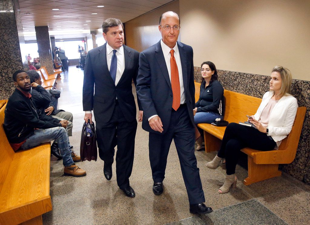 Toby Shook (left) and Robert Rogers, the attorneys representing former Dallas police officer Amber Guyger, leave the Dallas County criminal courthouse after meeting with the judge presiding over her case