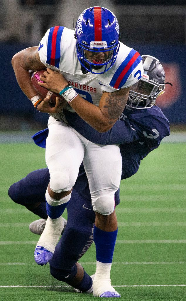 Duncanville quarterback Ja'Quinden Jackson (3) tries to break free from Flower Mound running back Markel Session in the first half of the Class 6A Division I area-round high school football playoff game at the AT&T Stadium in Arlington, Texas, on Saturday, November 23, 2019. (Lynda M. Gonzalez/The Dallas Morning News)