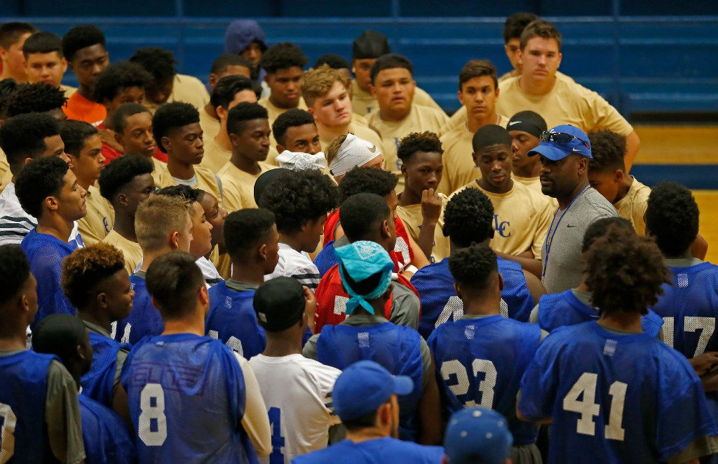 Lakeview Centennial Head Coach Kendall Miller (in a blue cap) talks with his players during practice inside the school gym in Garland, Texas, Monday, Aug. 14, 2017. The team had a practice session in the gym due to the weather. (Jae S. Lee/The Dallas Morning News)