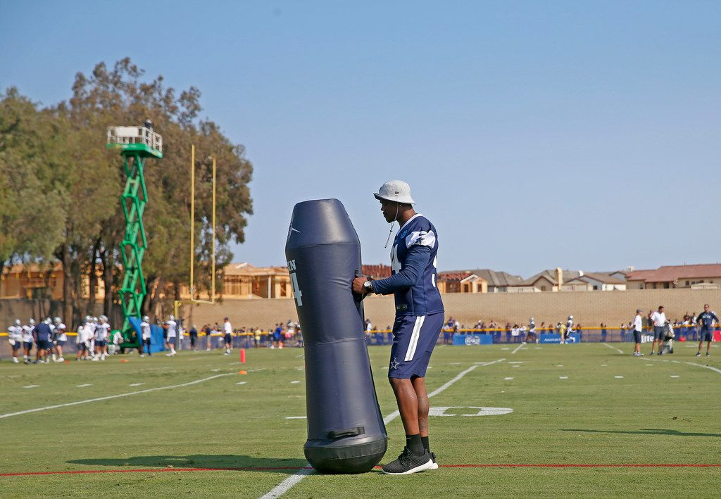 Dallas Cowboys defensive end Randy Gregory moves a blocking dummy during afternoon practice at the training camp in Oxnard, Calif., Friday, July 27, 2018. (Jae S. Lee/The Dallas Morning News)