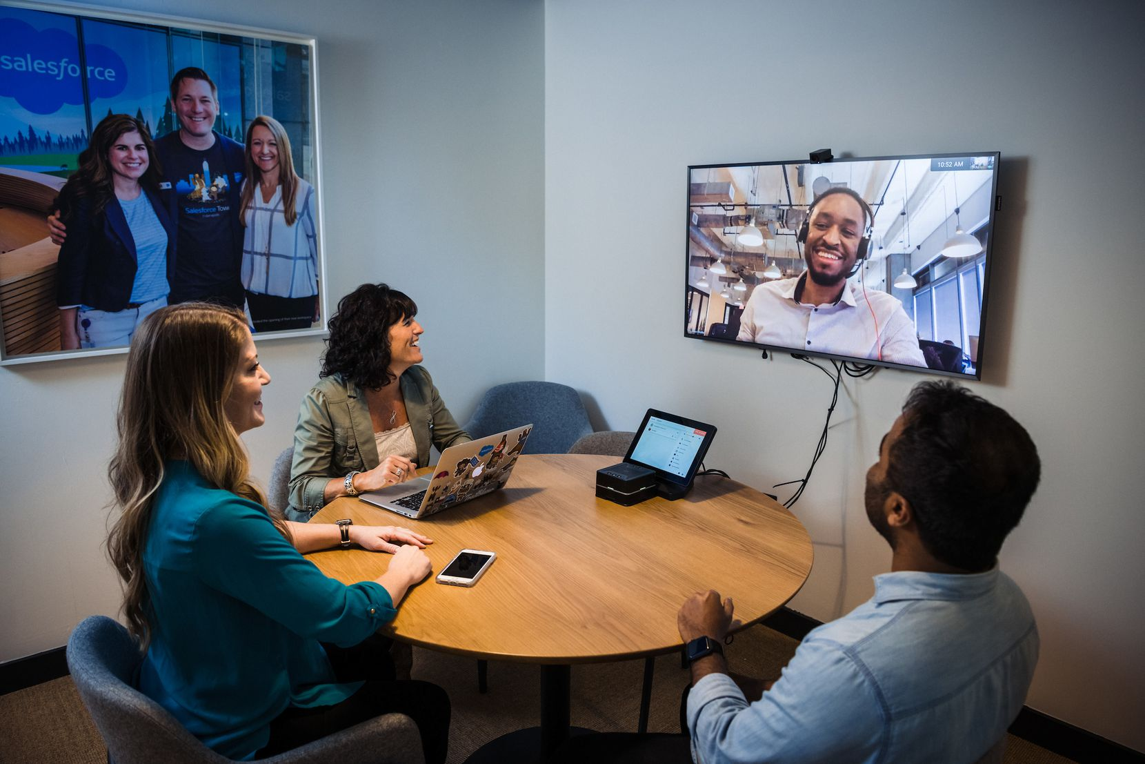 Salesforce employees catch up in a meeting that's part video, part live.