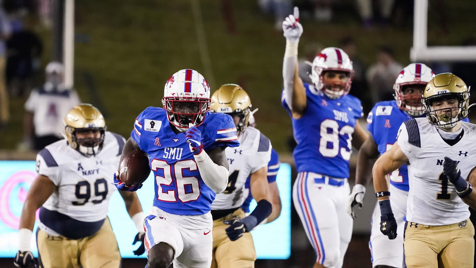 SMU running back Ulysses Bentley IV (26) gets by Navy linebacker John Marshall (1) on a 36-yard run during the second quarter of a game at Ford Stadium on Saturday, Oct. 31, 2020, in Dallas.