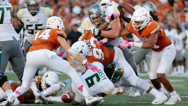 Baylor running back JaMycal Hasty (6) fumbles the ball after being tackled by Texas linebacker Anthony Wheeler (45) during the fourth quarter at Darrell K Royal Texas Memorial Stadium in Austin, Texas, Saturday, Oct. 29, 2016. The Longhorns won 35-34. (Jae S. Lee/The Dallas Morning News)