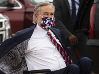 Gov. Greg Abbott rushes to meet Vice President Mike Pence at Dallas Love Field on Sunday, June 28, 2020, in Dallas. Pence is expected to speak at First Baptist Church's 'Celebrate Freedom Sunday Event' then speak with Abbott at a press event about the pandemic.