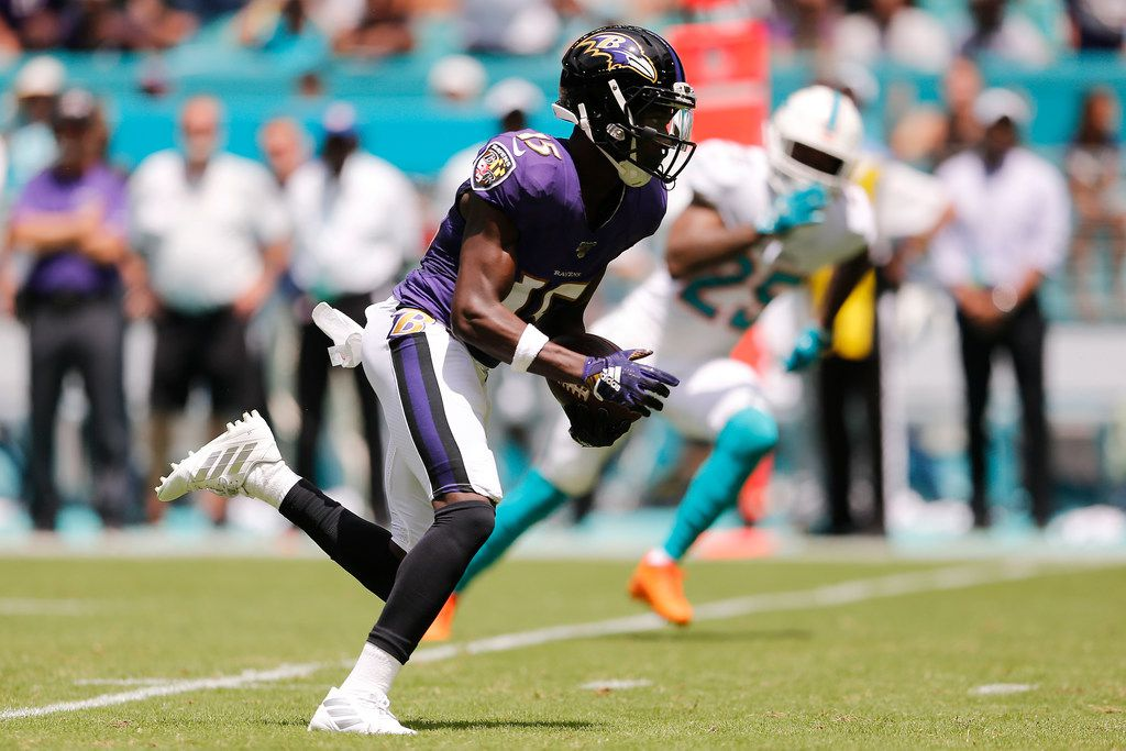 MIAMI, FLORIDA - SEPTEMBER 08:  Marquise Brown #15 of the Baltimore Ravens runs to the end zone to score a touchdown on a 47-yard pass from Lamar Jackson #8 (not pictured) during the first quarter against the Miami Dolphins at Hard Rock Stadium on September 08, 2019 in Miami, Florida. (Photo by Michael Reaves/Getty Images)