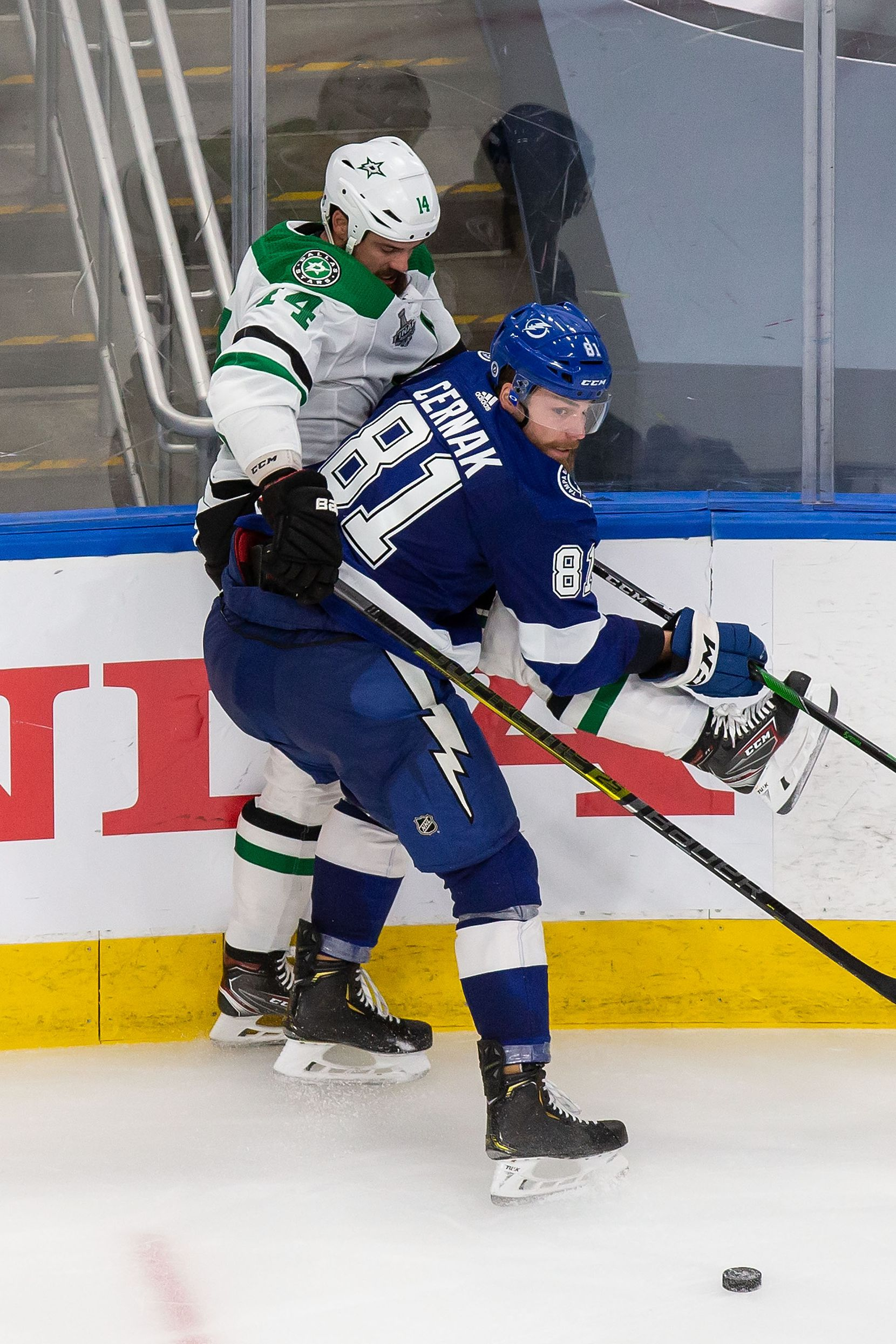 Jamie Benn (14) of the Dallas Stars battles against Erik Cernak (81) of the Tampa Bay Lightning during Game Two of the Stanley Cup Final at Rogers Place in Edmonton, Alberta, Canada on Monday, September 21, 2020. (Codie McLachlan/Special Contributor)
