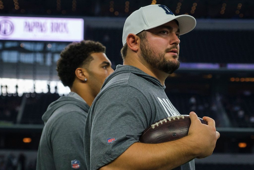 Dallas Cowboys offensive guard Zack Martin watches his teammates warm up before an NFL preseason football game against the Tampa Bay Buccaneers at AT&T Stadium on Thursday, Aug. 29, 2019, in Arlington.