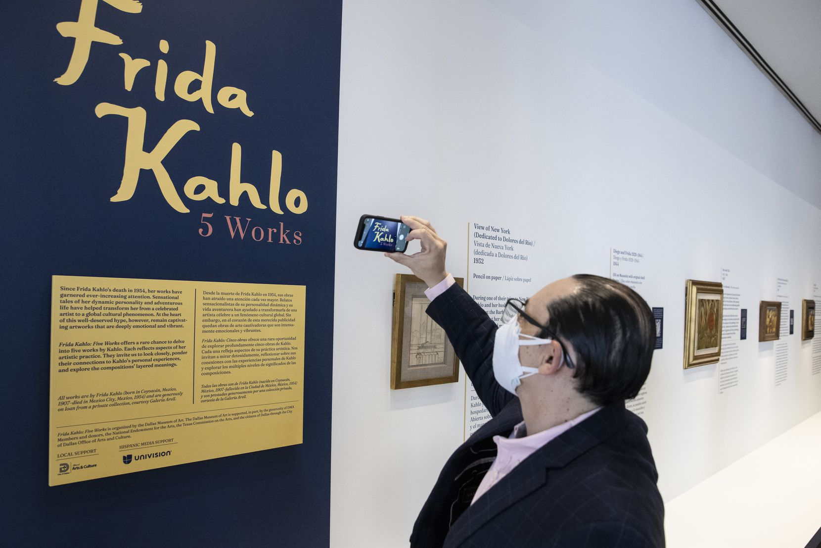 """Consul General of Mexico Francisco de la Torre Galindo takes a photo of the exhibit """"Frida Kahlo: Five Works"""" at the Dallas Museum of Art on Thursday, March 4, 2021."""