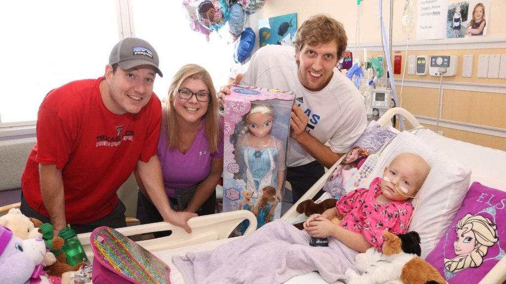 "Dirk Nowitzki visited Tatum Teague and her parents, Whitney and Tyler, at Children's Medical Center Dallas in December 2015. Tatum is believed to be the first to refer to Nowitzki as ""Uncle Dirk."""