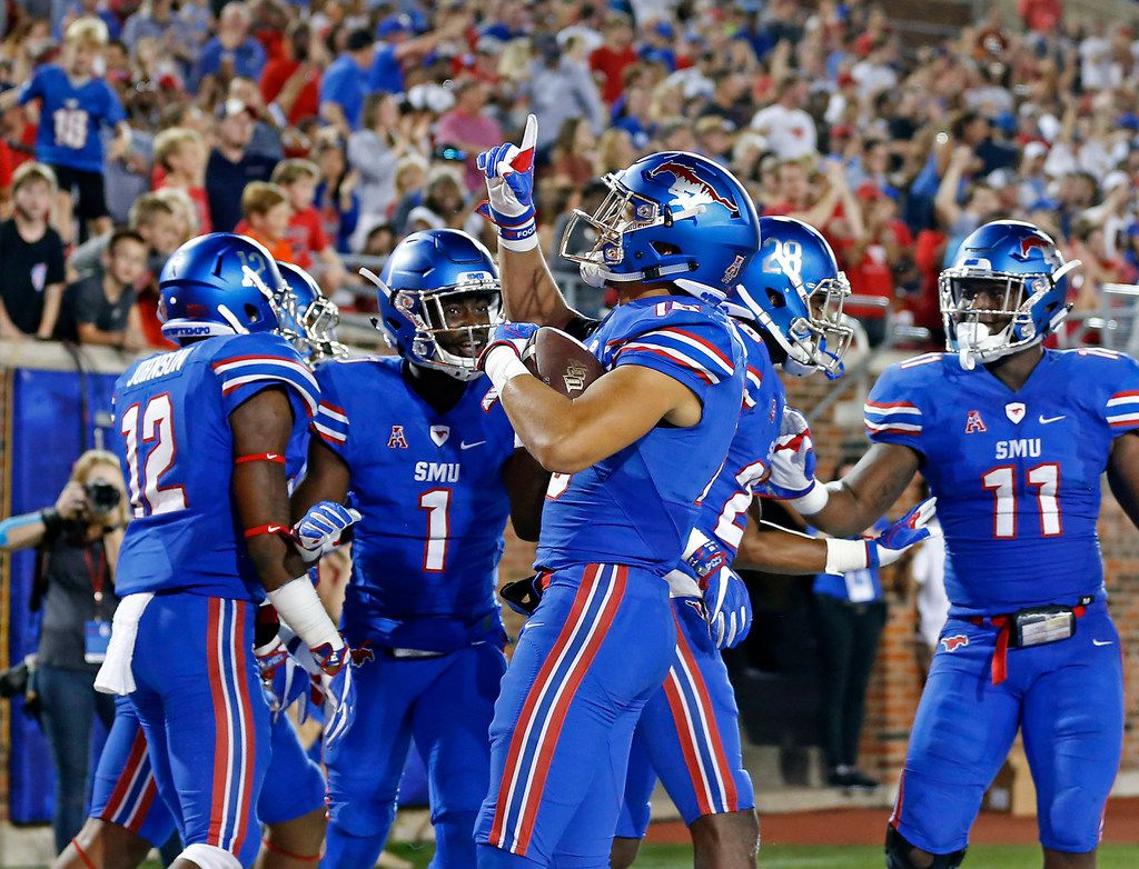 SMU defensive back Jordan Wyatt (15) celebrates with his teammates after he returns an interception for a touchdown past during the second quarter against UCF at Gerald J. Ford Stadium on Saturday, Nov. 4, 2017, in Dallas. (Jae S. Lee/The Dallas Morning News)