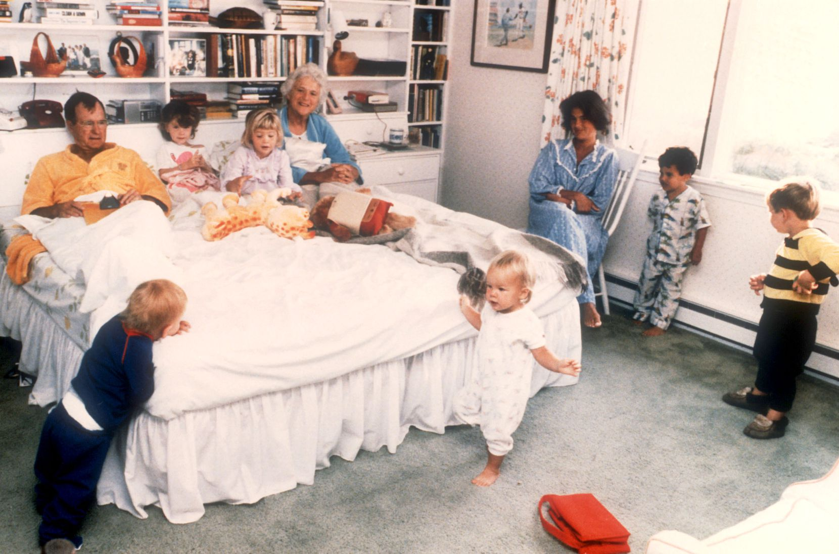 1987: Vice President George H.W. Bush and his wife Barbara are joined in their bedroom by six of their grandchildren at the family retreat in Kennebunkport, Maine. The spontaneous moment, shot by George H.W. Bush's personal photographer David Valdez, for use in LIFE Magazine, became an iconic photos of the Bush family. Valdez later became director of the White House photo office under Bush in 1988.