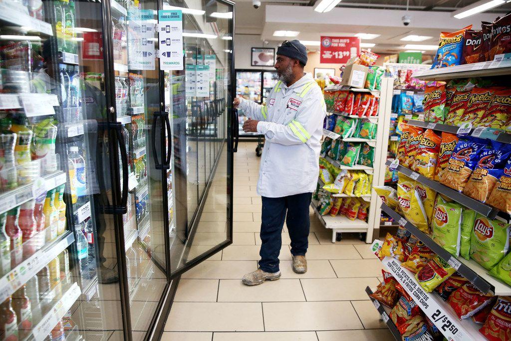Cedrick Williams picks out a Gatorade at 7-Eleven in downtown Dallas.
