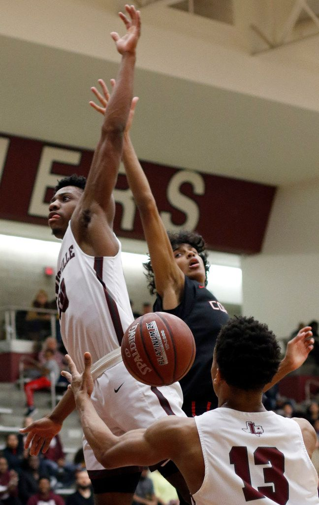Lewisville's OC Girtmon (10) left, is fouled on his drive to the basket when Coppell's Anthony Black (1) separated him from the ball during first quarter action. The two teams played their District 6-6A boys basketball game at Lewisville High School in Lewisville on January 28, 2020. (Steve Hamm/ Special Contributor)