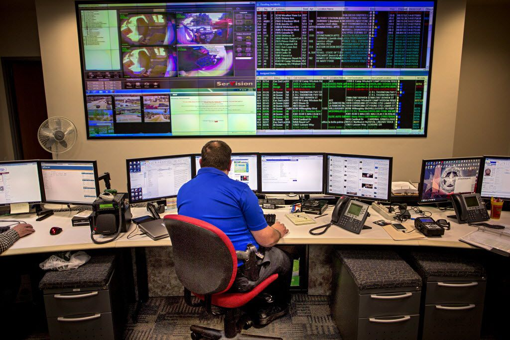 A Dallas police detective monitors screens at the DPD Fusion Center. DPD, like most police departments, works with the Texas Department of Public Safety in fusion centers that jointly investigate crime and monitor threats.