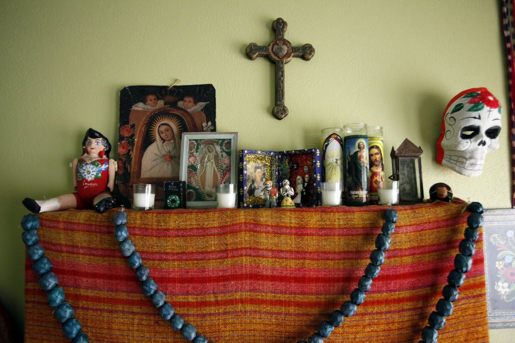 Details of an altar for Dia de los Muertos inside the home of  Melissa Love-Tristan, as part of her Halloween and Dia De Los Muertos decor, on Monday, Oct. 26, 2015 in Dallas. The untraditional altar does not include photographs or interests from a deceased member of the family, but according to Love-Tristan the altar does contain personal belongings from her and her husband's grandparents. Ben Torres/Special Contributor