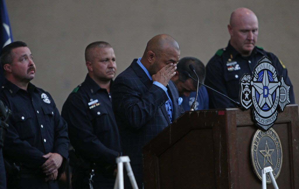 DPD Senior Corporal Castro #7634 speaks on behalf of Senior Corporal Ahrens #8193  during a candlelight vigil hosted by the Dallas Police Association at Dallas City hall in Dallas, TX July 11, 2016. (Nathan Hunsinger/The Dallas Morning News)