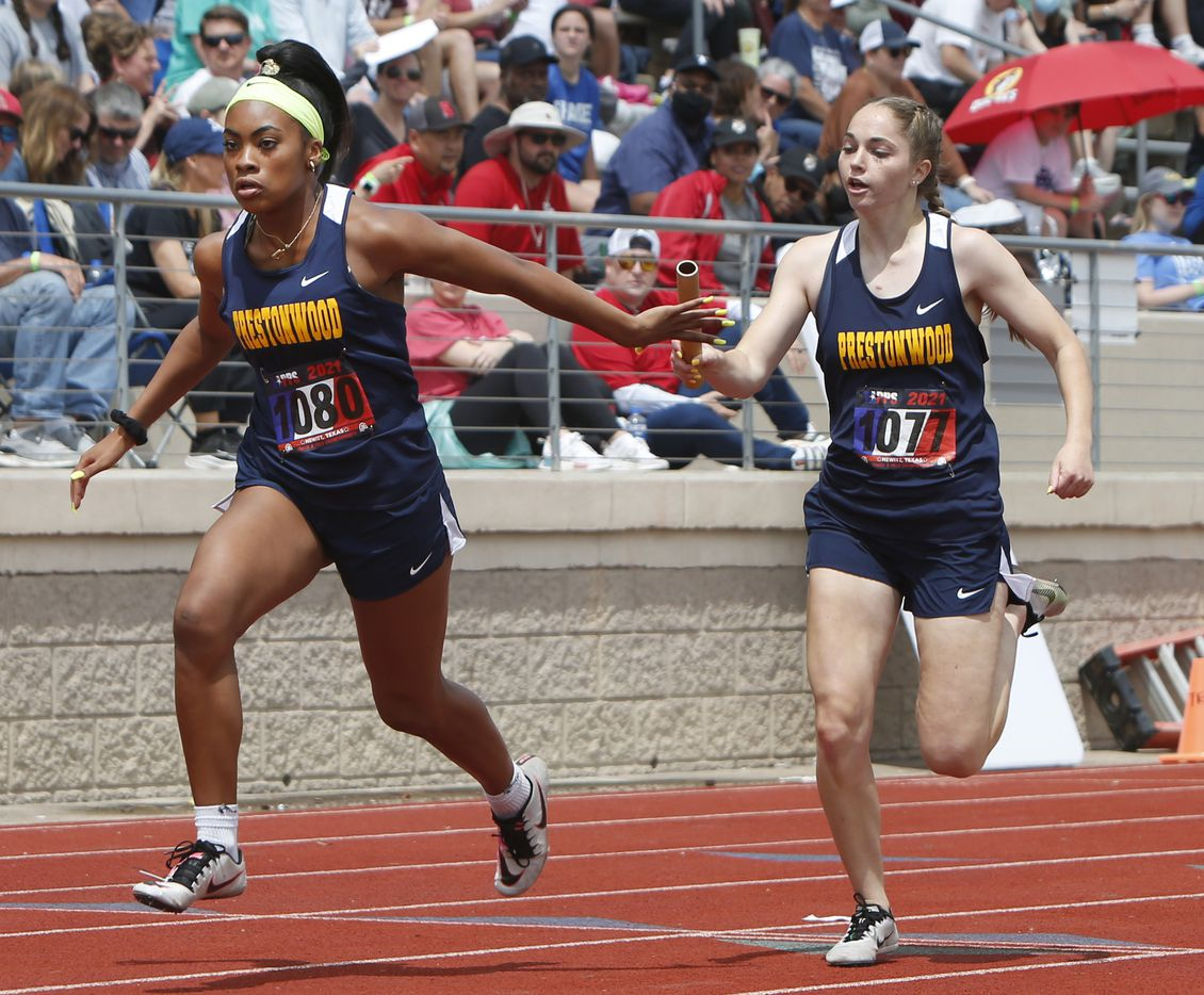 Plano Prestonwood's Jaden Matthews , right, passes the baton to teammate Hannah Stoutmire during the running of the Class 6A Women 4X200 Meter Relay event. Prestonwood finished first in the event. The running finals from the TAPPS state track meet were held at Waco Midway's Panther Stadium in Hewitt on May 1, 2021. (Steve Hamm/ Special Contributor)