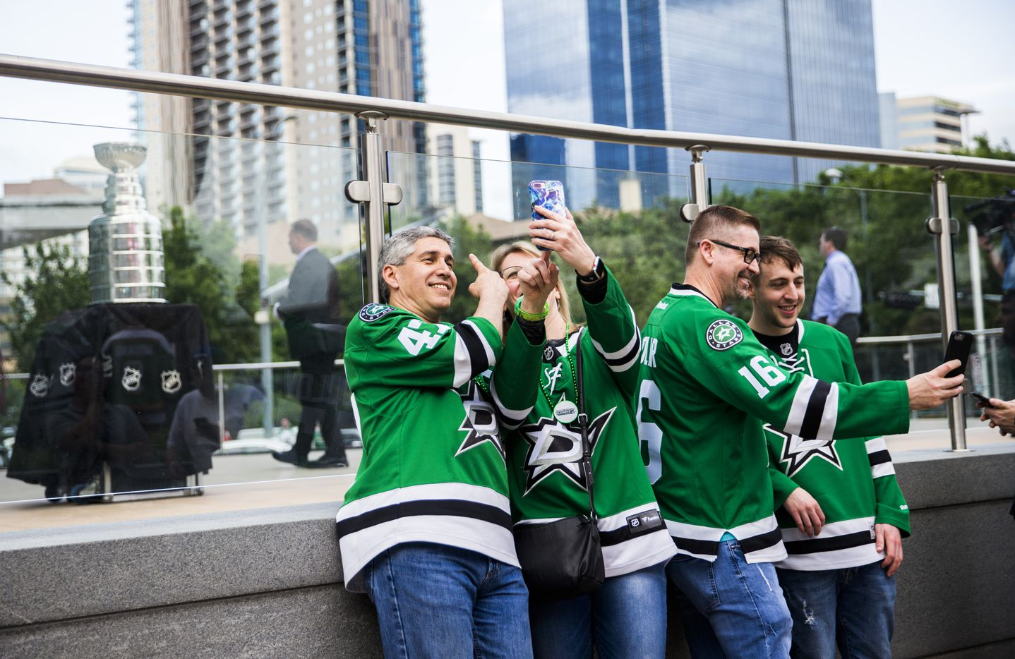 Fans take photos with the Stanley Cup outside American Airlines Center before Game 6 of the Stars-Predators playoff series.
