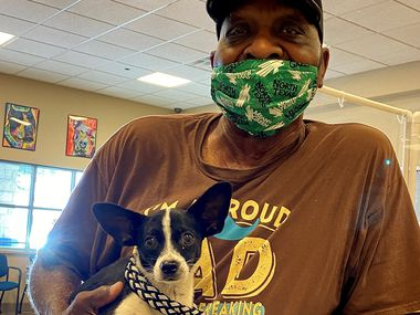 A Mesquite resident poses with the dog he is adopting. More than 80 animals found new homes during the Mesquite Animal Shelter's program from Aug. 24-Aug. 29.