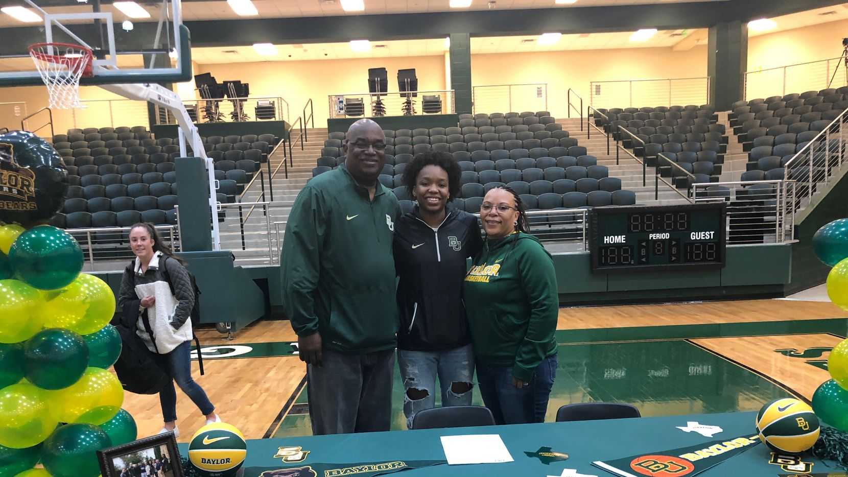 Prosper's Jordyn Oliver signed to play basketball with Baylor on Nov. 14, 2018. Jordyn (middle) is seen here with her father, Dwayne and her mother Carmell. (Photo courtesy of Jordyn Oliver)
