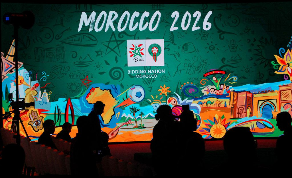 "A giant screen displays the logo of Morocco 2026 inside of the reception before a press conference to promote Morocco's bid for the 2026 soccer World Cup in Casablanca. The North American bid to host the 2026 World Cup has outscored Morocco following inspections with FIFA labeling the North African proposal ""high risk"" in three areas."