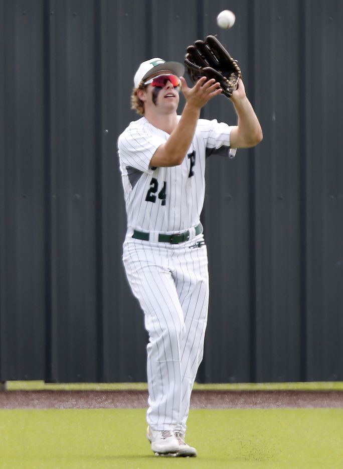 Prosper left fielder Jacob Devenny (24) catches a fly ball in the third inning as Prosper High School hosted Arlington Martin High School in a series final 6A Region I area round playoff game on Saturday afternoon, May 15, 2021. (Stewart F. House/Special Contributor)